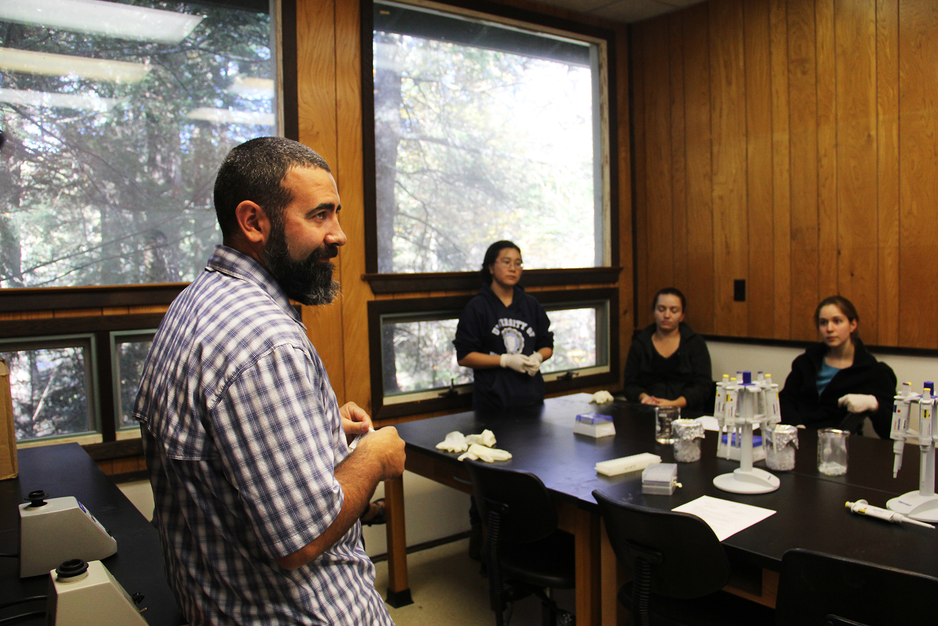 JJ Apodaca leans against a table in the lab and explains next steps