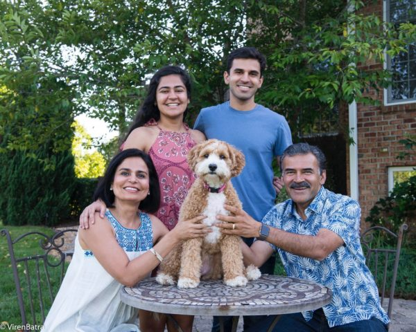 Kumar (left) with her two children, husband, and the family dog.