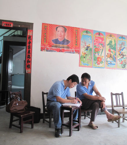 Conghe Song conducts a household survey during his project in China.