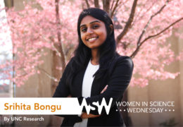Srihita-Bongu poses in front of a blossoming tree on campus