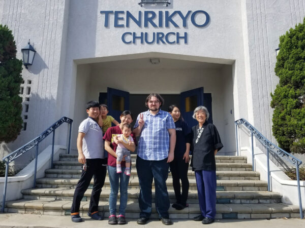 Timothy Smith poses with Tenrikyo practitioners in from of the mission headquarters in Los Angeles