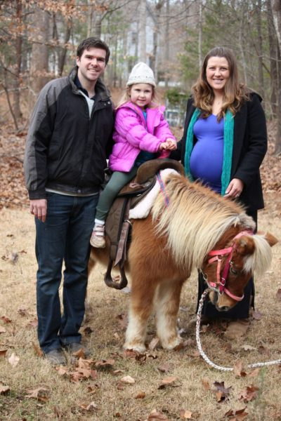Tully poses for a picture over the holidays with her daughter, husband, and a miniature horse.