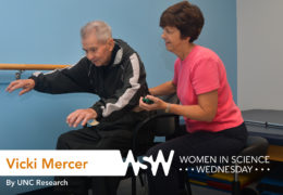 a woman helps an elderly man with balance