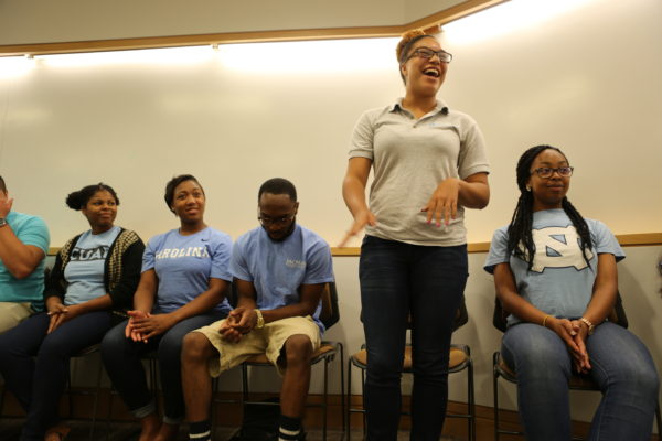 Burnett laughs with her students in UNC's Upward Bound Scholars program.