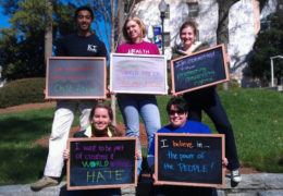 "Merino and several of her colleagues hold blackboards as part of their World Day of Social Justice celebration at Emory University a couple of years ago. Merino's blackboard says ""I believe in the of the people!"""