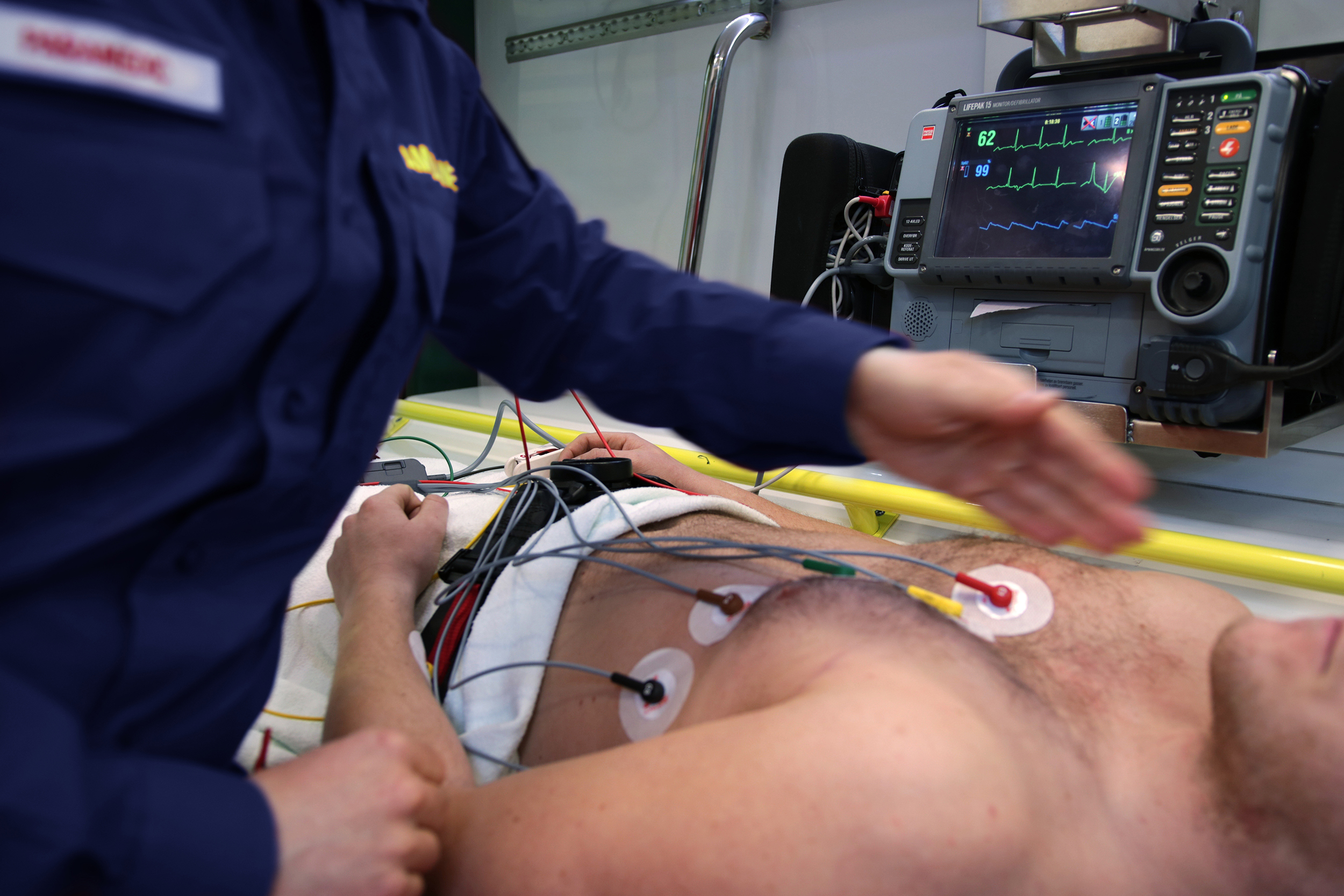 EMT measures the heart rate of a patient