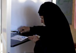 Photo of an older Egyptian woman casting her vote during the second round of a referendum.