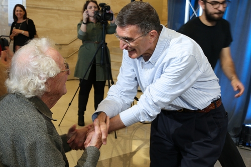 Oliver Smithies, winner of the 2007 Nobel, congratulates Aziz Sancar on his 2015 Nobel win.