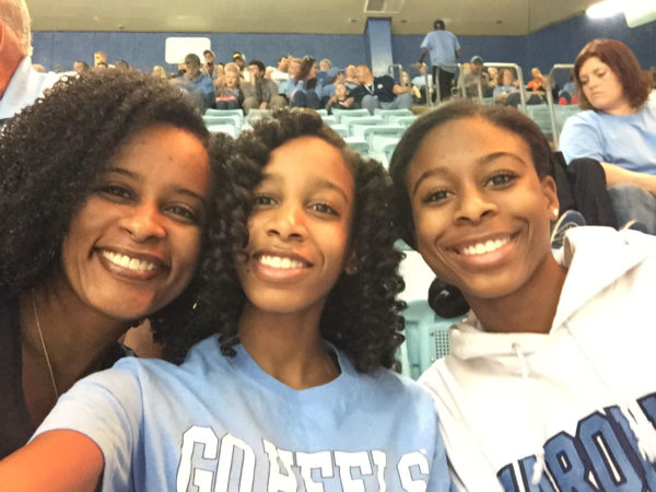 Karen Sheffield and her two daughters at a Carolina basketball game