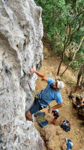 Esteban Agudo climbs a rock wall