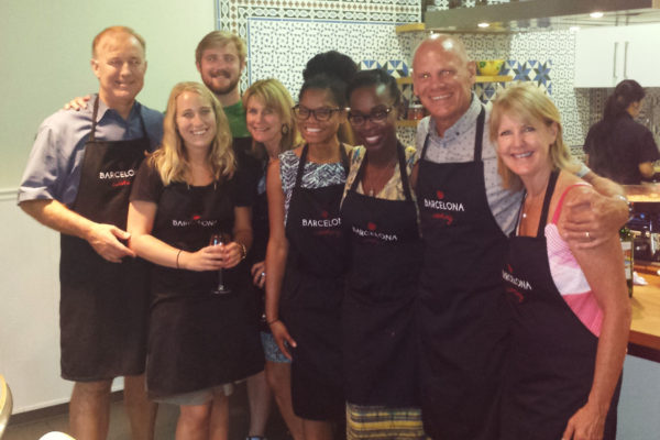 a group of people wearing black aprons