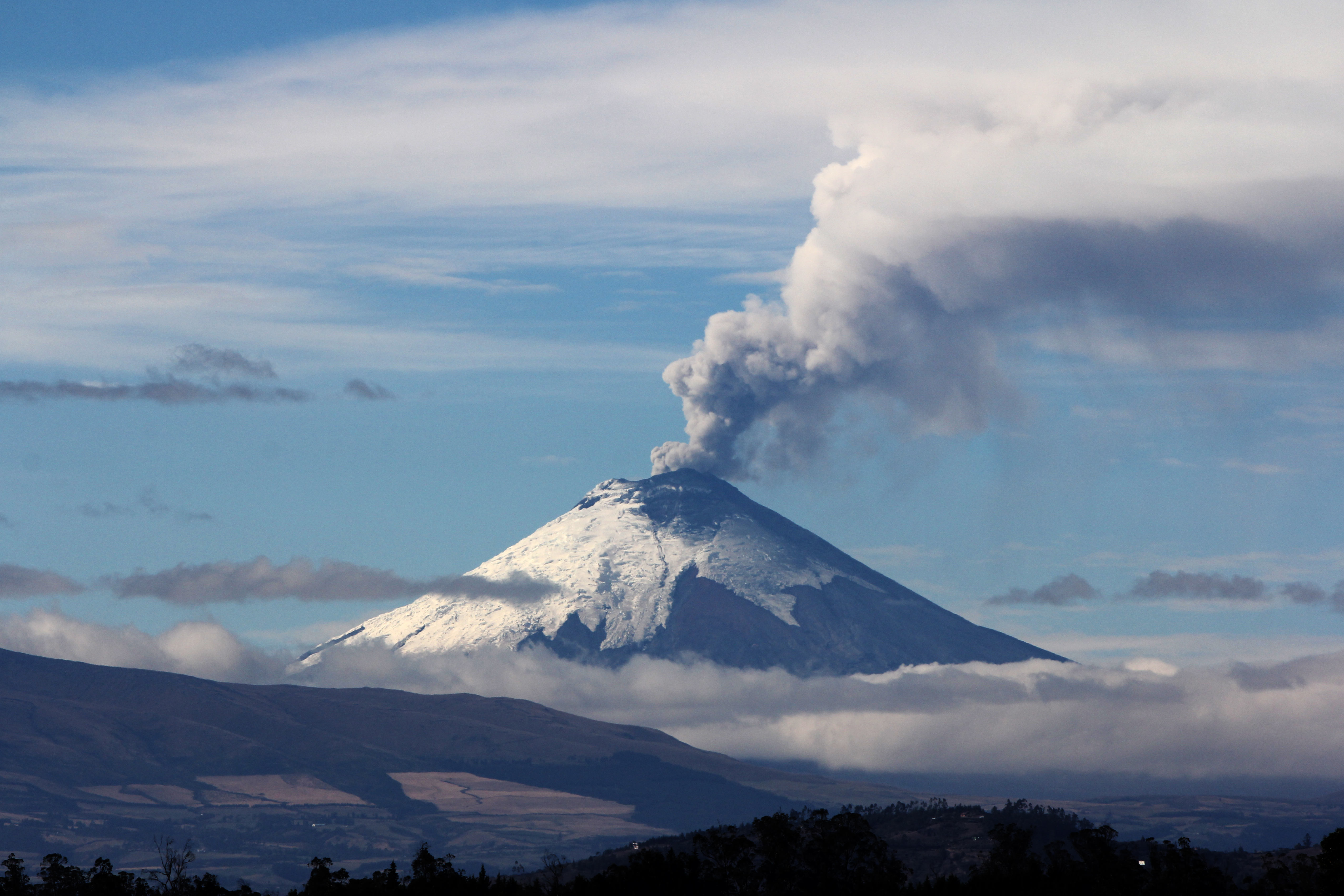 Cotopaxi, one of South America's most dangerous volcanoes, emits a mixture of volcanic gases and steam on October 19, 2015. Photo by Mary Lide Parker.