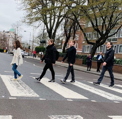 Seth Noar, his wife Elsa, and their two kids cross a crosswalk