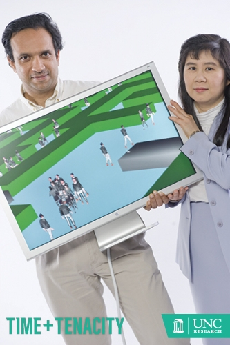 Photo by Steve Exom Dinesh Manocha (left) and Ming Lin hold a computer showcasing a modeling and simulation program called OneSAF (One Semi-Automated Forces), a defense technology and simulation tranining they developed to teach soldiers how to stay alive in the combat zone.