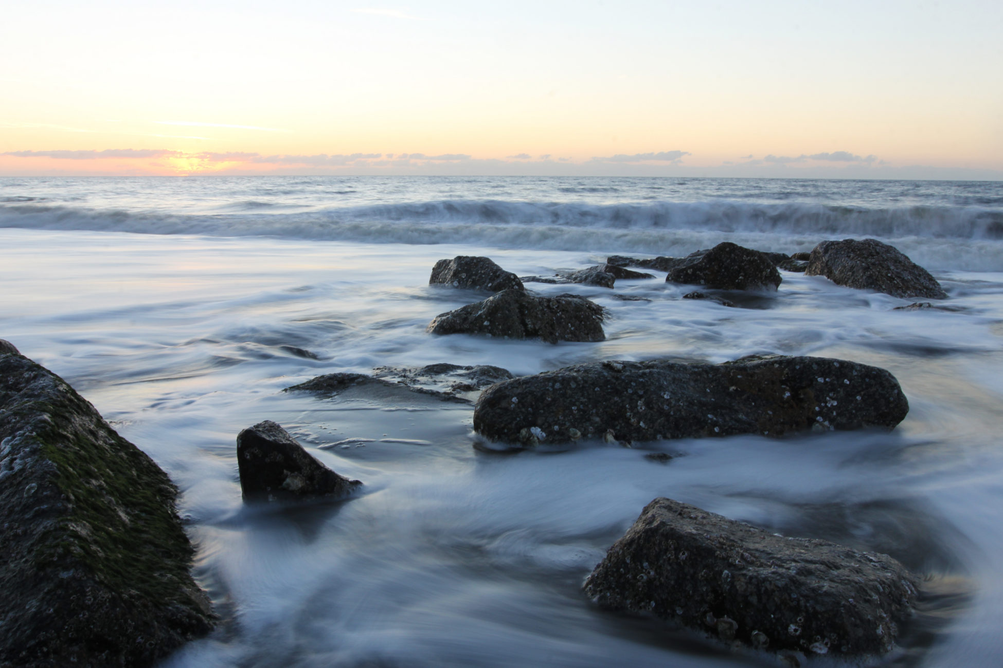 The beach tide starts to recede at the sun rises