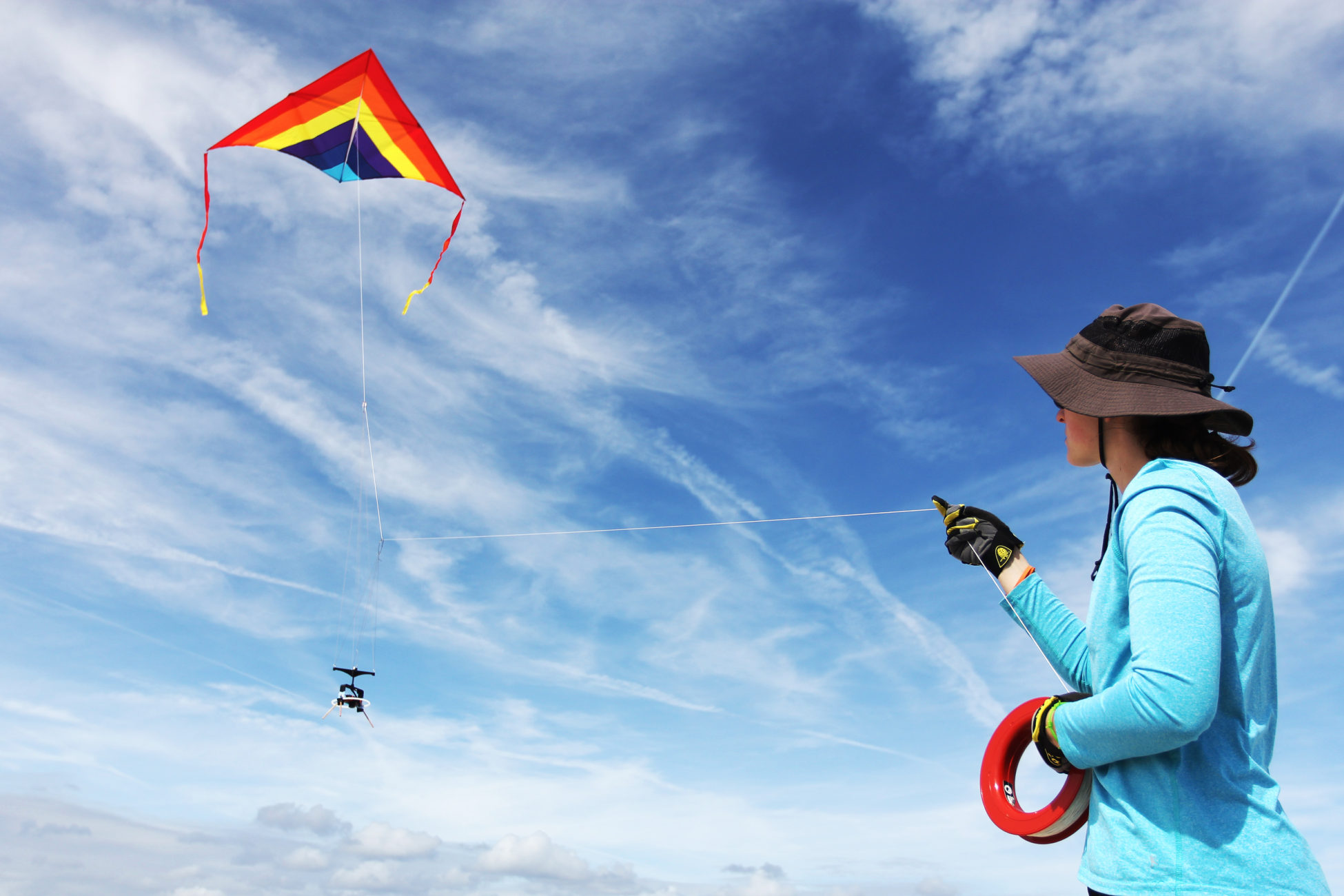Elsemarie deVries flies a kite out on the beach with a camera attached to conduct an aerial survey