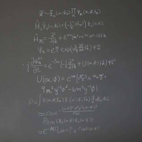 a series of equations on a blackboard that represent the origin of the universe