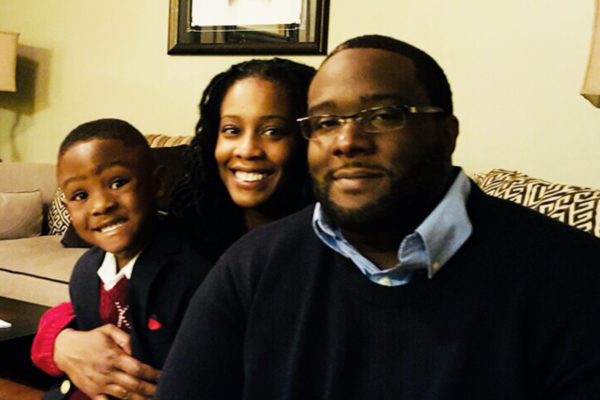 Erika Wilson (center) with husband (right) and son (left)