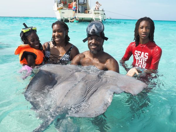 Teshanee Williams (second from left) with her two kids and husban at Grand Cayman Island