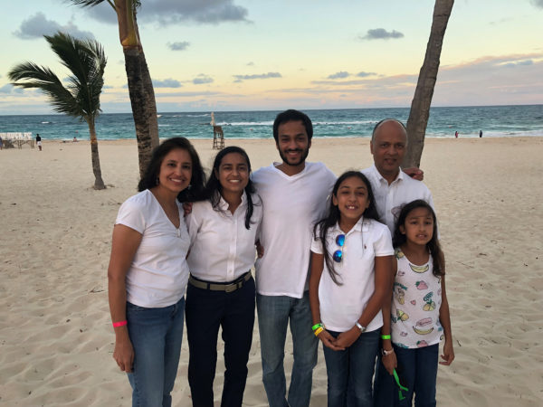Garg (right) with her husband and four children in the Dominican Republic.