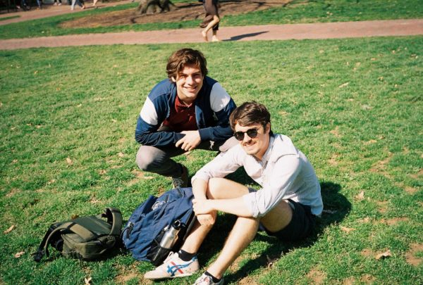 Michael Doucette and his friend hang on the quad