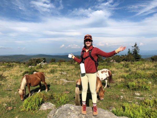 Macy Salzberger with wild ponies in Grayson Highalnds Virginia