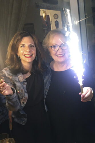 Daphne Klotsa and her mother, who is holding a sparkler