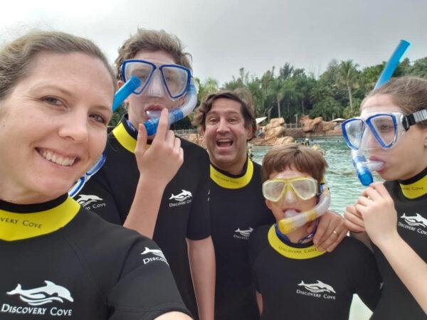 Claudio Battaglini (center) with his three children and wife in scuba gear