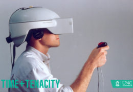 Grad Student tests out the virtual reality headset.