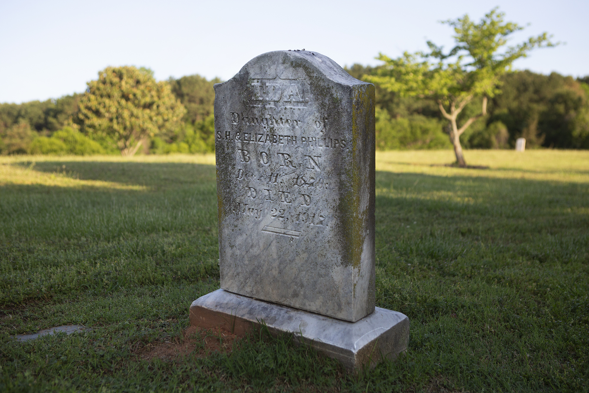 Detailed photo of a grave marker in the hospital cemetery.