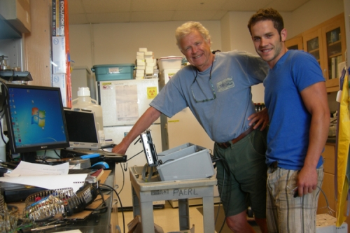 Photo of Hans Paerl and Ph.D. student Joey Crosswell posing in the lab.