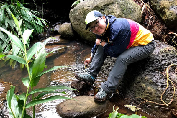 Xiao-Ming Liu collects water from a mountain stream in Hawaii