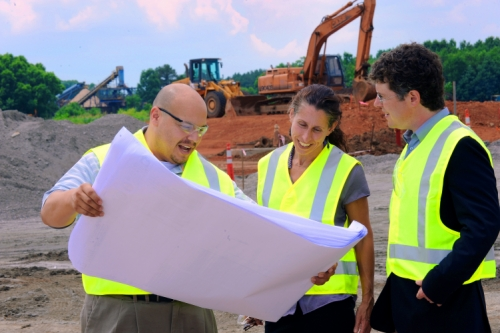 Walter Rivera shows zoning maps to Heather Hunt and Gabriel Cumming in Warren County.