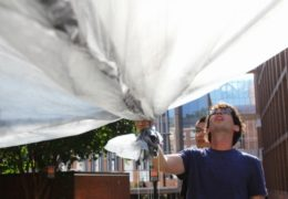 Danny Bowman holds the end of his homemade solar balloon, preparing to launch it. Click the image to start the video.