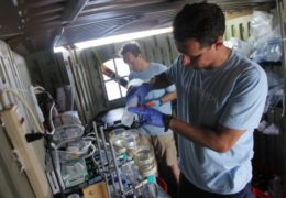 Photo by Mary Lide Parker UNC oceanographers Adrian Marchetti and Scott Gifford filter water samples just collected from the Equatorial Pacific in a garden shed on the Sierra Negra, a Galápagos National Park Service vessel.