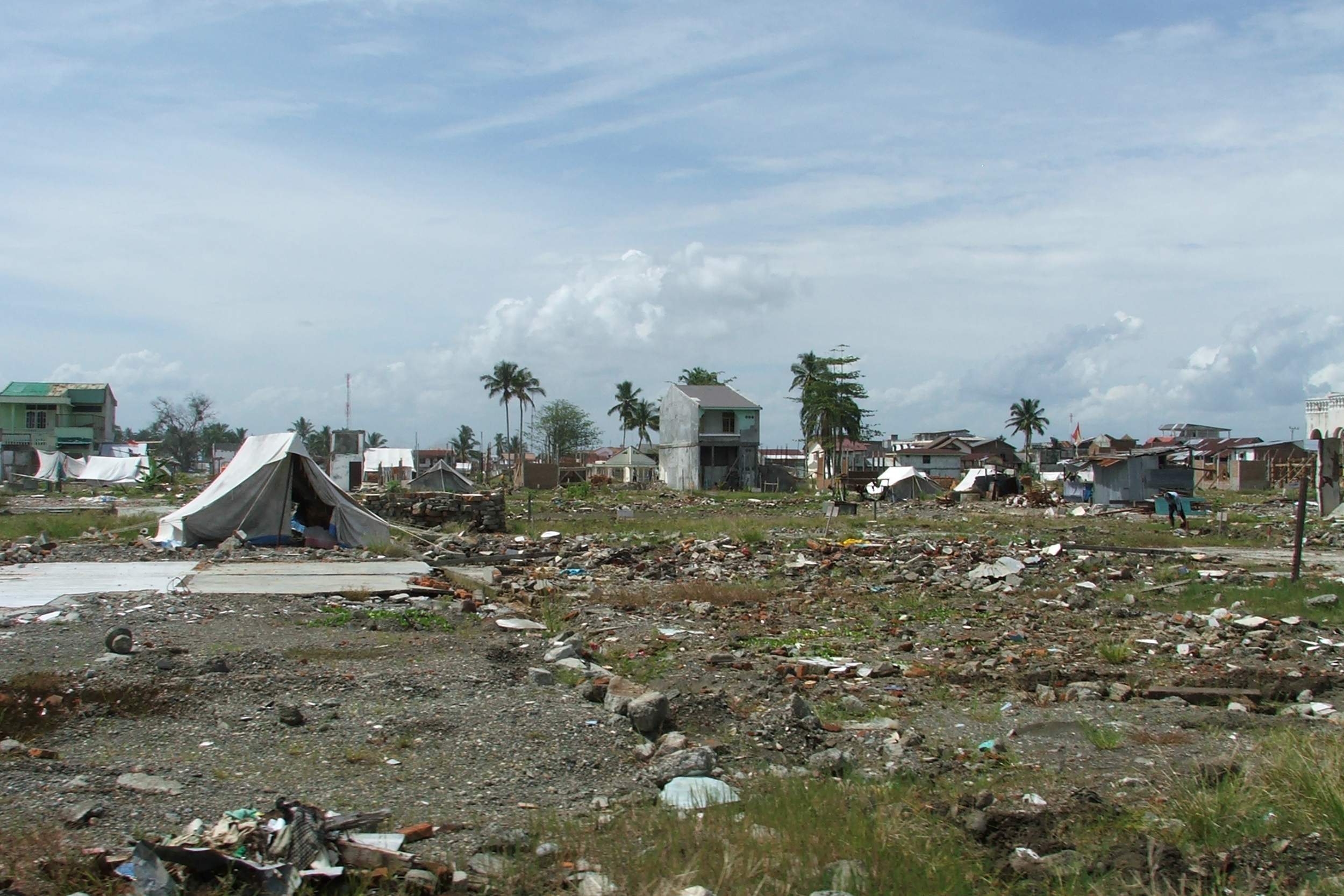 battered homes and debris fill the landscape after the 2004 Indian Ocean tsunami