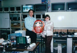 Pozefsky and Hiroshi Takayasu, then-manager of the IBM Japan Olympics Networking team, hold a Daruma Doll
