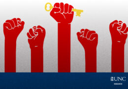 a graphic of five red hands making fists in the air; the middle hand holds a key