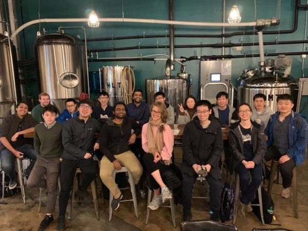 a group from the neurolanguage processing lab pose at a local brewery