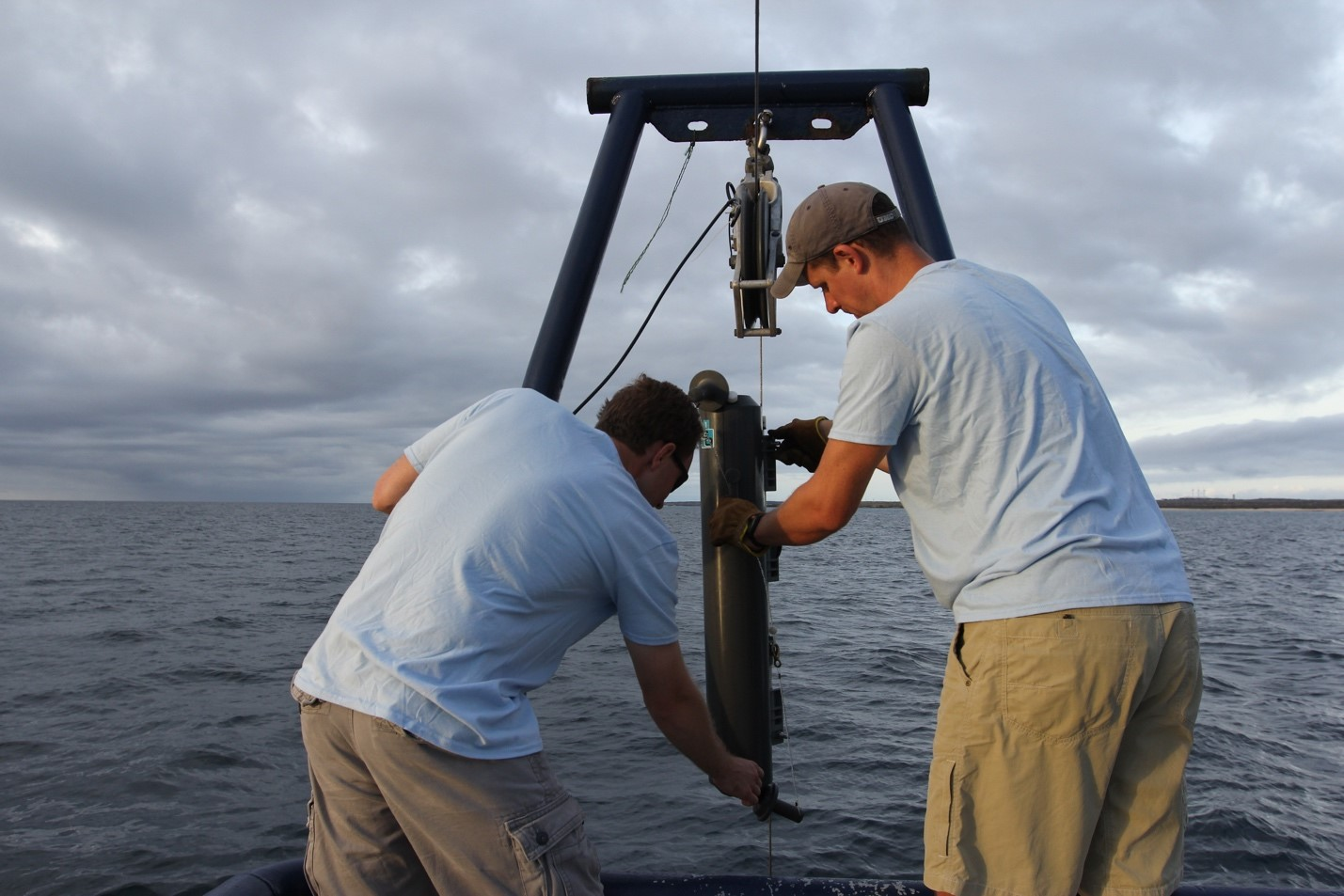 two men prepare a rig that will collect water near the Galapagos