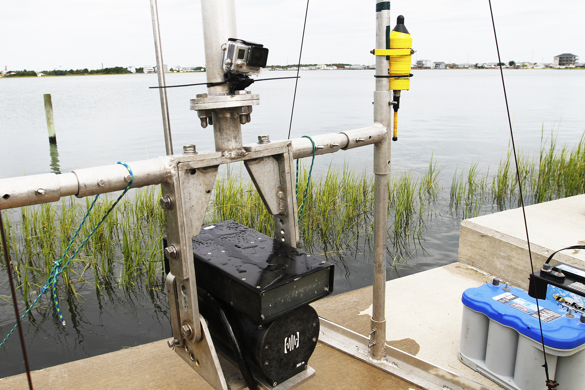 "The metal rig allows the DIDSON (an acoustic camera) to be suspended in the water. The battery pack powers the DIDSON, while a mounted GoPro camera captures the complete lack of visibility in the water. The yellow hydrophone records the varied soundscape of the marsh. ""Some fish and crustaceans make really unique sounds,"" Smith says. ""Snapping shrimp make a noise like someone snapping their fingers."" Capturing those sounds is another way to measure the amount of diversity and activity in the marsh."
