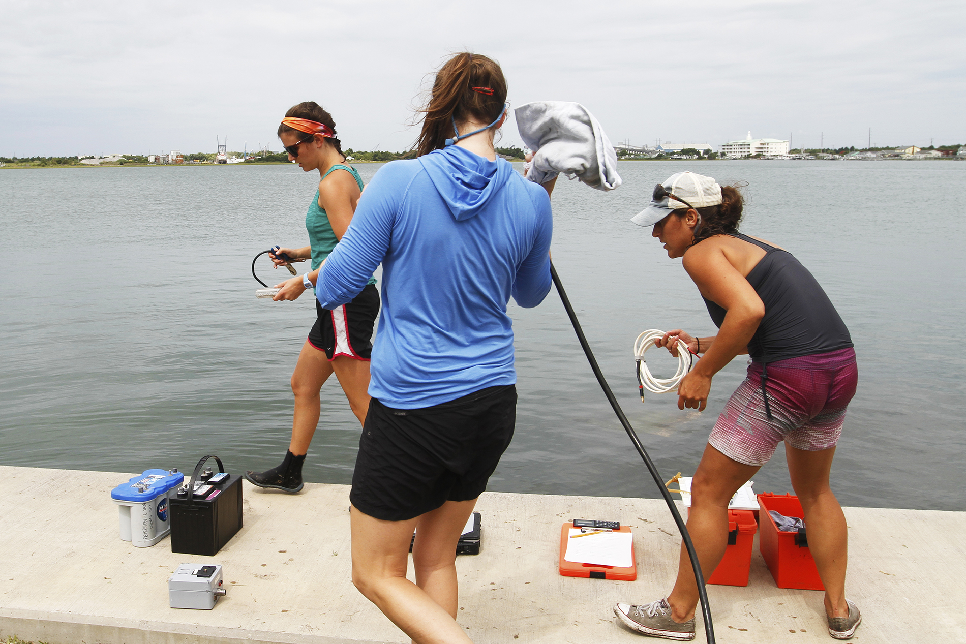 Like a well-oiled machine, Gaesser, Paxton, and Smith efficiently unload their gear from the truck and begin setting up for their second sample site.