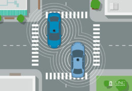 "Illustration of two self driving cars at a overhead view. There are ""sonic ways"" emitting from the cars, showing that they are ""talking"" to one another."
