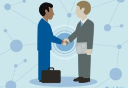 Illustration of two business men shaking hands.
