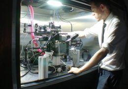 Photo of Spencer Smith working with the microscope that his lab created.