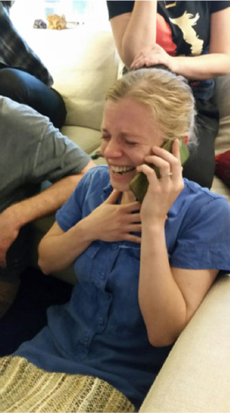 Cardman crying tears of happiness as she's on the phone.