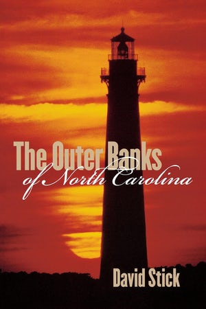 "Cover of ""The Outer Banks of North Carolina"" by David Stick showing a lighthouse silhouetted against an orange sunrise."