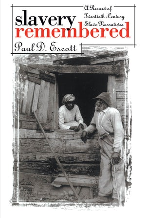"Cover of ""Slavery Remembered"" by Paul D. Escott showing a photograph of a Black woman and man wearing slavery-era clothing conversing through an open window."